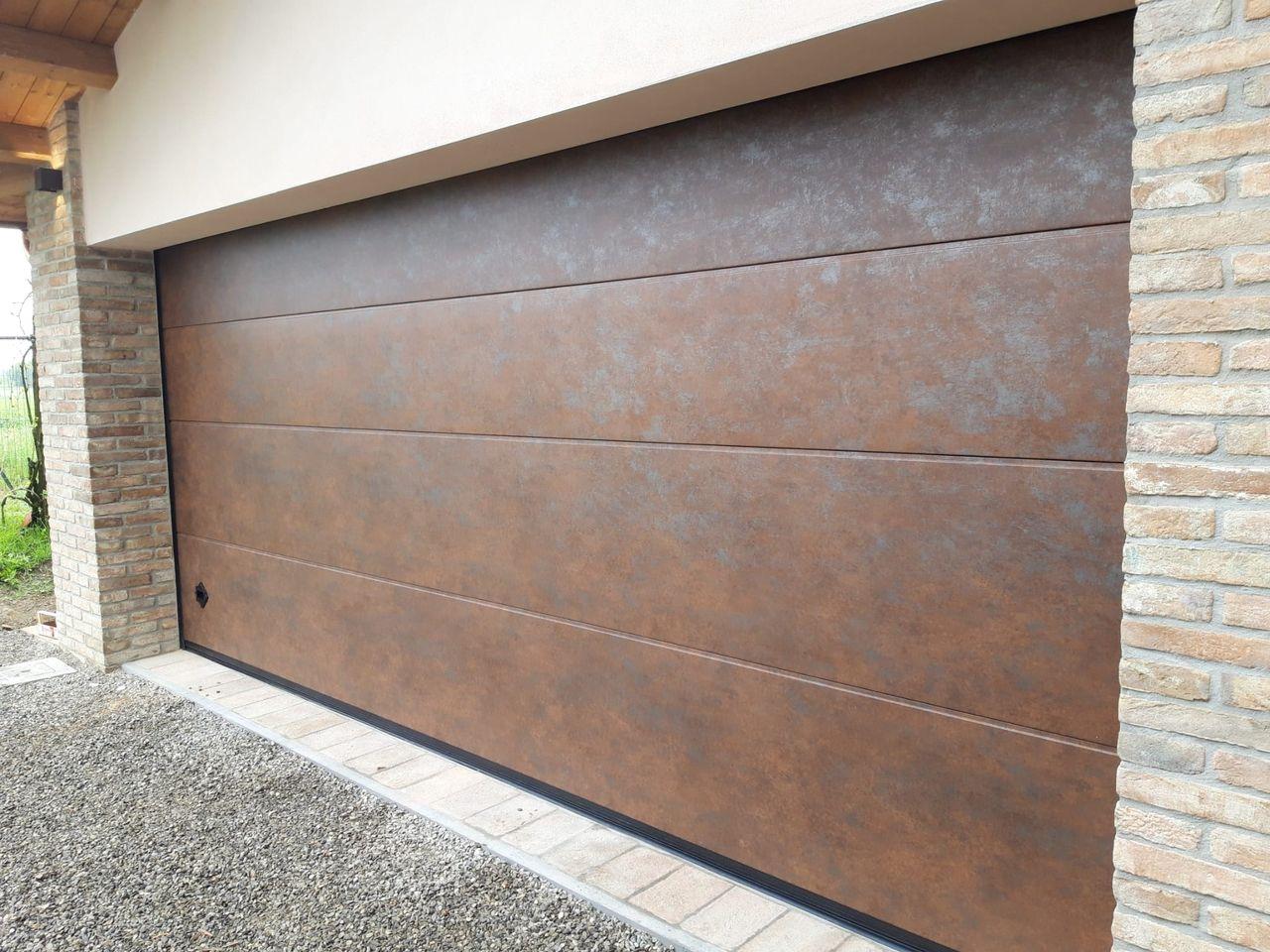 Porte sezionali Simil legno e Corten Mantova Modena Reggio Emilia Verona